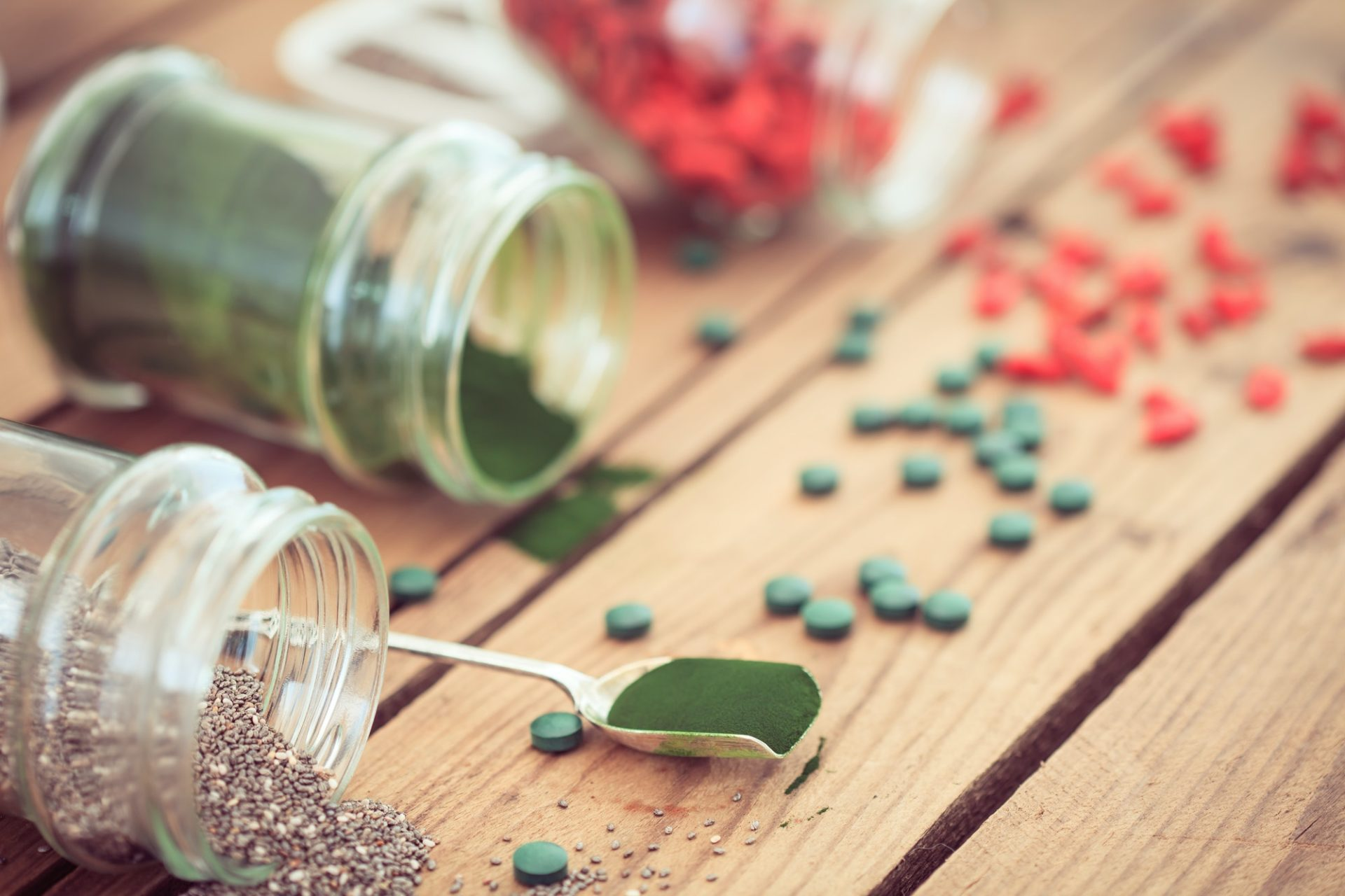 Goji, spirulina and chia seeds (superfood) on wooden tabe