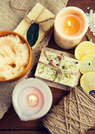 close-up-of-natural-soap-and-candles-on-wood.jpg